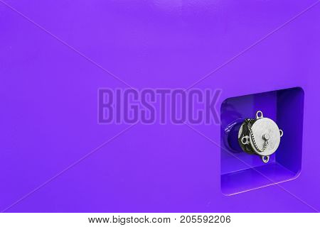 fuel filler is on the blue metal case construction equipment