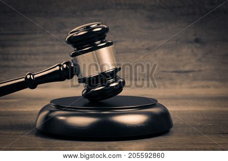 Judge's hammer on wooden table. Judge Law And Justice Symbol.