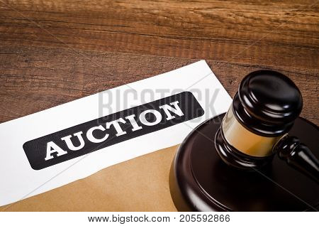 Auction document with wooden gavel. Business concept.