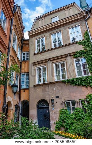 WARSAW, POLAND - JUNE, 2012: Beautiful historical buildings of Canon square with the narrowest townhouse in Europe