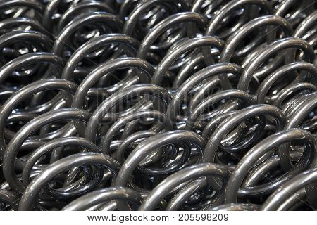Production of springs of shock absorbers .
