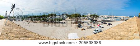 Antibes, France - July 01, 2016: wide angle view of port Vauban and skyline in Antibes France. Port Vauban is the largest marina in the Mediterranean Sea