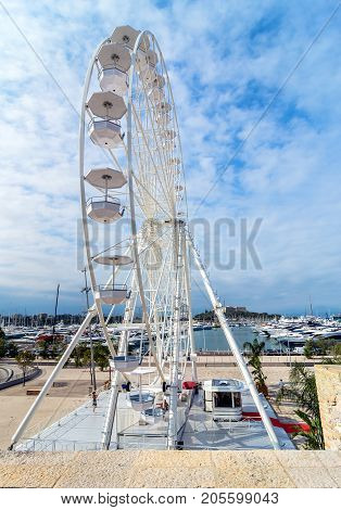 Antibes France - July 01 2016: day view of port Vauban and grande roue in Antibes France. Port Vauban is the largest marina in the Mediterranean Sea.