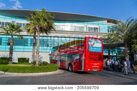 DUBAI UAE - JANUARY 26 2016: Touristic Big Bus excursion City Sightseeing Dubai The Day Tour is a hop-on hop-off tour of Dubai with a personal recorded commentary available.