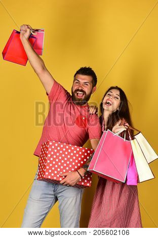 Man With Beard Holds Polka Dotted Box. Shopping And Spending