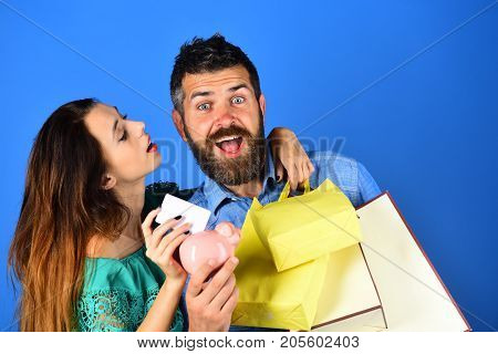 Guy With Beard And Girl With Excited Faces Do Shopping.