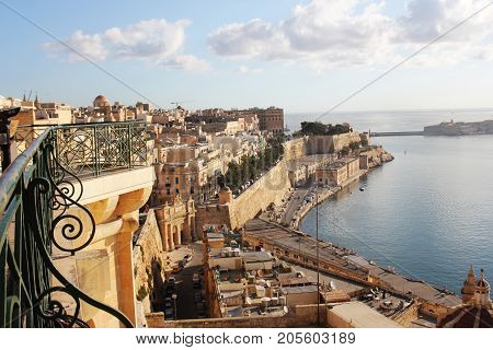 Panoramic view over the Grand Harbour from the Upper Barrakka gardens in Valletta, Malta .
