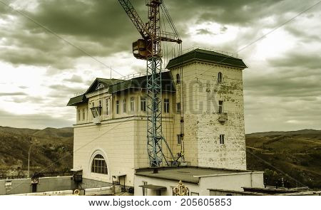 Old building of the dam in Ust-Kamenogorsk. Old architecture.Historic architecture. Old city. Historical heritage. Antuque building.