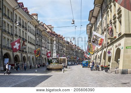 Bern Switzerland - May 26 2016: Street view on Kramgasse with fountain in the old town of Bern city. It is a popular shopping street and medieval city centre of Bern Switzerland.
