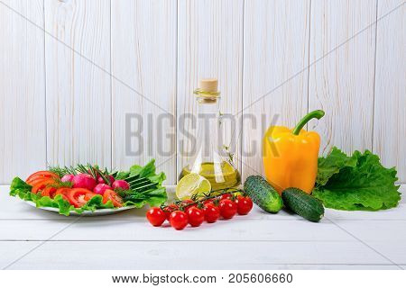 Cucumbers, Radish, Tomatoes Cherry, Olive Oil, Herb And Spices On Old White Wooden Background. Set F