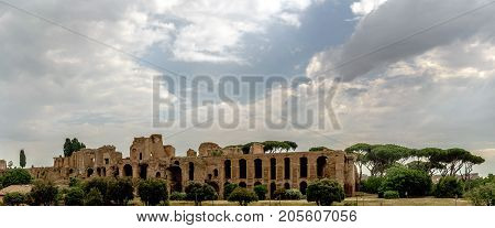 Archaeological Ruins Of The Severian Arcades On The Palatine With A Sky With Many Clouds. View From