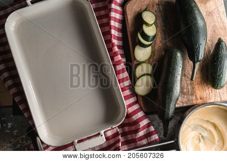 Form for baking, zucchini, cheese sauce mornay horizontal
