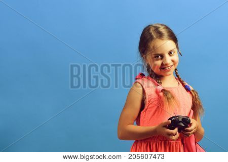 School Girl With Shy And Smiling Face Expression On Blue