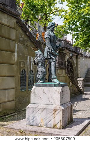 Bern Switzerland - May 26 2016: The bear that is the city symbol stands behind the founder of Bern at Zahringer Denkmal Monument in Bern Switzerland.