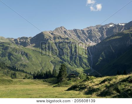 Scenic Alpine rocky alpine valley of Sportgastein in summer. Picturesque mountain pasturelands, great mountain massif and sunny weather. Sport hiking landscape background.