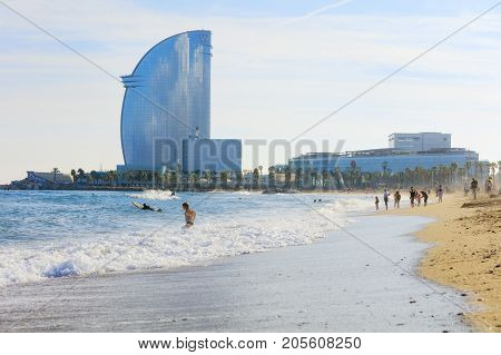 Barcelona, Spain - Oct 23, 2016: People relaxing on Barcelonetta beach on sunny day