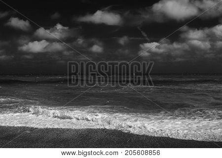 A monotone image of a stormy sea and sky at Eastbourne UK