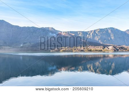 landscape of active volcano Baru Jari Lake Segara Anak and summit of Rinjani mountain. Lombok island Indonesia.