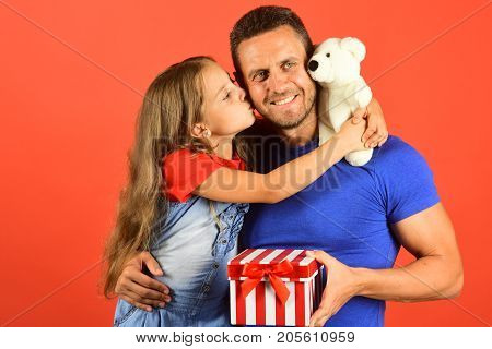 Schoolgirl And Dad Hold Present Box And White Teddy Bear.