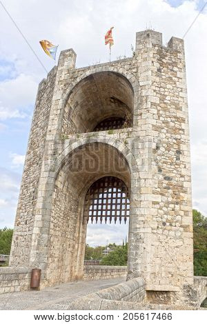 Portcullis Of A Gate With The Flag Of The Independence Over It, Besalú, Spain