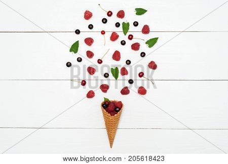 Top View Of Sweet Raspberries, Cherries And Black Currants In Waffle Cone With Free Space. Fresh Ber
