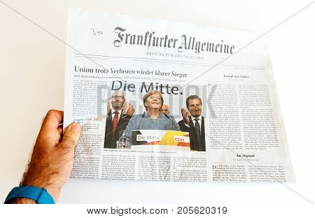 PARIS FRANCE - SEP 25 2017: frankfurter allgemeine german newspaper with portrait of Angela Merkel after election in Germany for the Chancellor of Germany the head of the federal government