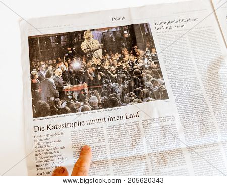 PARIS FRANCE - SEP 25 2017: International newspaper with portrait of AMartin Schulz after election in Germany for the Chancellor of Germany the head of the federal government