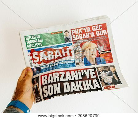 PARIS FRANCE - SEP 25 2017: Sabah Turkish daily newspaper with portrait of Angela Merkel after election in Germany for the Chancellor of Germany the head of the federal government