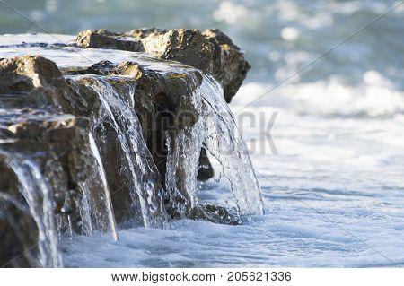 water falling over rocks in maui hawaii