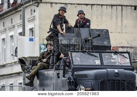 Gryfino Poland 23 september 2017: Historical reconstruction of the battle at Arnhem German soldiers riding a large military car.