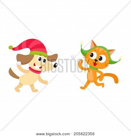 Cute little cat and dog characters playing snowballs, having fun, winter activity, cartoon vector illustration isolated on white background. Little baby cat and dog animal characters playing snowballs