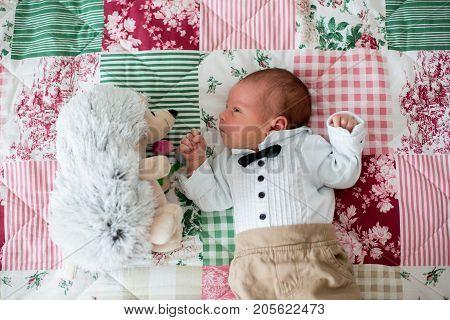 Beautiful Little Newborn Baby Boy, Dressed As Little Gentlemen, Sleeping In Bed