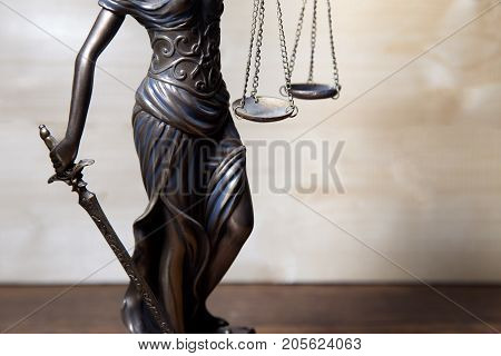 Scale of justice held by Lady Justice