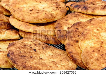 Hot And Fresh Baked Flatbread On A Frill For A Picnic