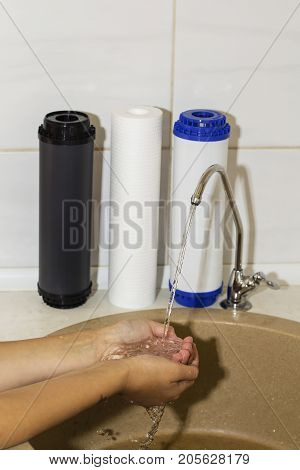 Great filters to purify your drinking water an image isolated in the kitchen interior.