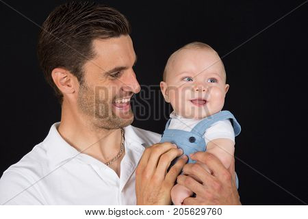 a Happiness Baby on the fathers hands