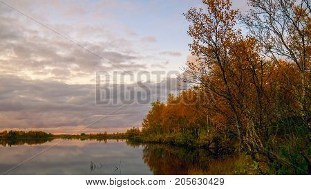 Forest lake.Sunset on lake in autumn forest