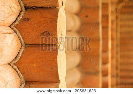 Close-up of elements of a wooden blockhouse and its walls in the Scandinavian northern style
