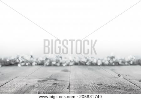 Black And White Christmas Background With Rustic Wooden Surface And Soft Focus Lights And Tinsel