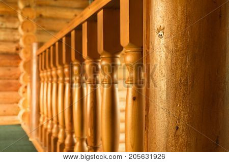 Close-up row of wooden column wooden stairs in russian wooden blockhouse