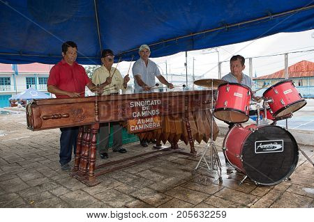 January 11, 2015 Flores, Guatemala: Men Playing Marimba Music On The Street Of The Popular Tourist D