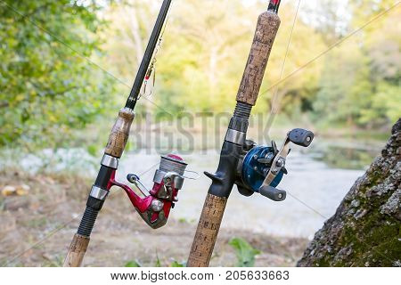 Two fishing rods with reels. One reel spinning and second baitcasting reel