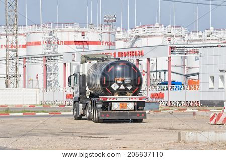 Truck With Tank For Transportation Of Petroleum Products Stay On The Road In Front Of Refinery