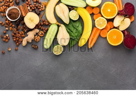 Healthy food. Ingredients for detox smoothie, vivid fruits and vegetables on gray background., top view, copy space.