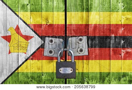 Zimbabwe flag on door with padlock close