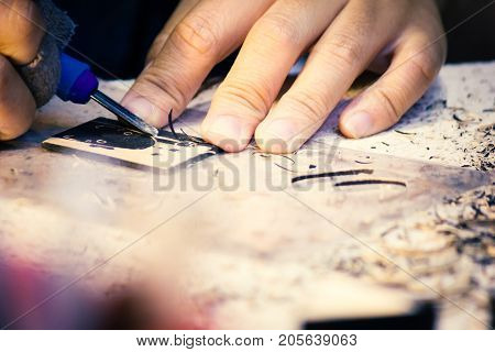 Hands Of Craftsman Carve With Engraving Tool On Table Workbench In Carpentry Work Learning Craftsman Profession In Art Class.