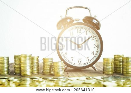 Stack Of Gold Coins With Black Fashioned Alarm Clock For Display Planning Money Financial And Business Accounting Concept Time To Work At Make Money Concept Vintage Color Tone