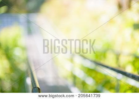 steel suspension footbridge in mountains - image with natural extremely shallow depth of field - ready for background