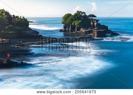Pura Tanah Lot in the morning famous ocean temple in Bali Indonesia.