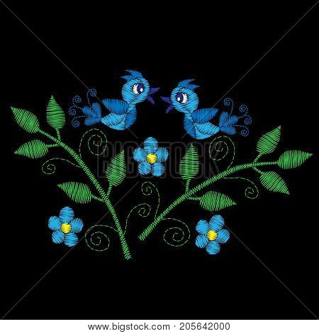 Blue bird on the brunch with flower embroidery stitches imitation. Template for fabric textile patch or print. Fashion bird and flower embroidery. Vector embroidery on black background.